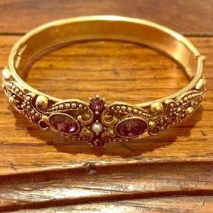 Avon bangle with purple stones